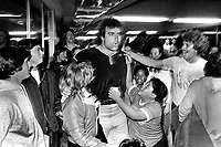 Oakland Raider John Matuszak mobbed by fans at the Oakland Airport after returning from Cleveland with playoff win. (Jan 4,1981 photo by Ron Riesterer)