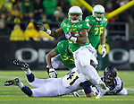 Oct 07, 2015; Eugene, OR, USA; Oregon Ducks running back Kani Benoit (29 )evades California Golden Bears' defenders at Autzen Stadium. <br /> Photo by Jaime Valdez