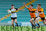 Michael Potts, Dr. Crokes in action against Michael O'Gara and Jack Morgan, Austin Stacks in their match between Austin Stacks and Dr Crokes in the Kerry Senior football championship at Austin Stack Park on Friday night.