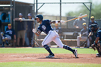 San Diego Padres shortstop Gabriel Arias (13) follows through on his swing during an Instructional League game against the Milwaukee Brewers at Peoria Sports Complex on September 21, 2018 in Peoria, Arizona. (Zachary Lucy/Four Seam Images)