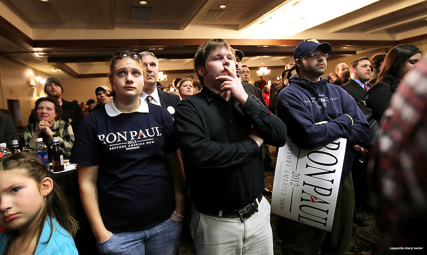 Ron Paul supporters, Amanda Christakis, second from left, of Turner, and Chris Dixon of Lisbon, third from left, watch the straw poll results at the Maine Caucus Night Party in Portland ME, Saturday, Feb. 11, 2012 . (Cheryl Senter for the New York Times)