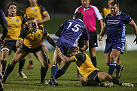 Joe LUCA SMITH of London Scottish is tackled during the Championship Cup match between London Scottish Football Club and Ealing Trailfinders at Richmond Athletic Ground, Richmond, United Kingdom on 23 November 2018. Photo by David Horn/PRiME Media Images