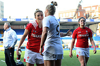 Pictured: Keira Bevan of Wales and Natasha Hunt of England hug at full time during the Women's six nations championship match between Wales and England at Cardiff Arms Park, Cardiff, Wales, UK. Sunday 24 February 2019