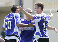 9 April 2005:  SJ Earthquakes' Brad Davis celebrates with Ronald Cerritos and Wade Barrett after scoring a goal during the first half of the game against Chivas USA at Spartan Stadium in San Jose, California.   San Jose Earthquakes tied Chivas USA, 3-3.   Credit: Michael Pimentel / ISI