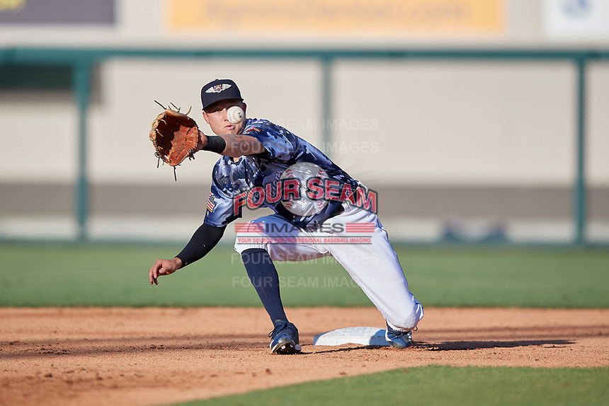 Lakeland Flying Tigers shortstop A.J. Simcox (12) stretches for a throw down on a stolen base during a Florida State League game against the Dunedin Blue Jays on May 18, 2019 at Publix Field at Joker Marchant Stadium in Lakeland, Florida.  Dunedin defeated Lakeland 3-2 in eleven innings.  (Mike Janes/Four Seam Images)