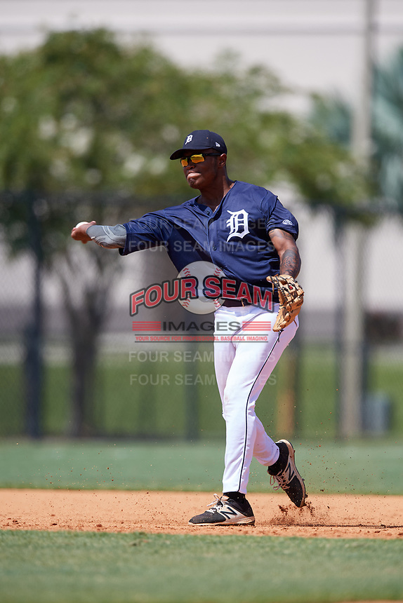 GCL Tigers East shortstop Kelvin Smith (4) throws to first base during a game against the GCL Tigers West on August 8, 2018 at Tigertown in Lakeland, Florida.  GCL Tigers East defeated GCL Tigers West 3-1.  (Mike Janes/Four Seam Images)