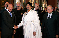 Il leader libico Muammar Gheddafi stringe la mano al presidente del Senato Renato Schifani, a sinistra, durante la sua visita a Palazzo Giustiniani, Roma, 11 giugno 2009. A destra, il senatore Lamberto Dini..Libyan leader Libyan leader Muamar Gadhafi shakes hands with the Italian Senate's president Renato Schifani, left, during his visit at Palazzo Giustiniani, Rome, 11 june 2009. At right, senator Lamberto Dini..UPDATE IMAGES PRESS/Riccardo De Luca