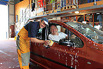 "Sean Flanagan (Clogherhead Lifeboat) and Jimmy ""Banjo"" Shevlin in the first car washed during the ""Car Wash"" for the Clogherhead RNLI at the RNLI Station on Saturday 24th August 2013 <br /> Picture:  Thos Caffrey/ www.newsfile.ie"