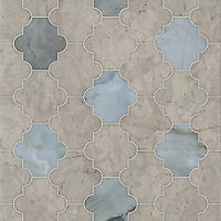 Andre, a waterjet cut stone mosaic, shown in polished Pacifica and honed Palomar, is part of the Semplice™ collection for New Ravenna.