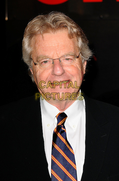 "JERRY SPRINGER .The ""Jerry Springer / Chicago"" photocall, Cambridge Theatre, Earlham St. London, England..February 17th, 2009. black suit jacket headshot portrait glasses orange blue tie.CAP/CAN.©Can Nguyen/Capital Pictures."