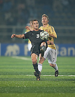 Tyler Polak (3) kicks the ball agains Iker Muniain (7).. Spain defeated the U.S. Under-17 Men National Team  2-1 at Sani Abacha Stadium in Kano, Nigeria on October 26, 2009.
