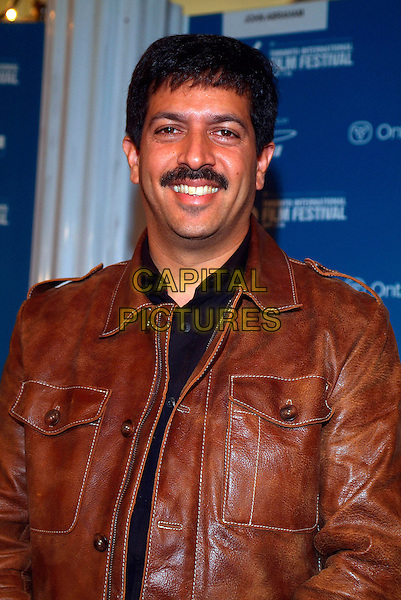 "KABIR KHAN.The ""KABUL EXPRESS"" Press Conference at the Sutton Place Hotel during the Toronto International Film Festival, Toronto, Ontario, Canada, 14 September 2006..half length moustache brown leather jacket.Ref: ADM/BP.www.capitalpictures.com.sales@capitalpictures.com.©Brent Perniac/AdMedia/Capital Pictures."