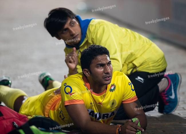 Mens Hockey World league Final Delhi 2014<br /> Day 3, 12-01-2014<br /> Indian v Germany Day 3<br /> V R Raghunath get a massage during the first half<br /> Photo: Grant Treeby / treebyimages