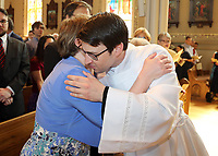 Michael Block gives his mother Robin a hug.
