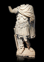Roman statue of an Emperor with a breastplate (loricata) from the 2nd cent AD from the Imperial Villa, Rome. The statue depicts a man in military dress, with a breastplate (lorca) decorated within griffins and a cluster of acanthus, and edged by a series of pendants (pteryges) with a head of ferocious animals and a cloak (paludamentum). In his left hand remains the traces of a sword; his raised right arm probably leant on a spear. On his feat he wears shoes decorated at the ankles with a lion skin. The statue dates from the dynasty of the Antonine Emperors and is the dress of the supreme military commander.  The National Roman Museum, Rome, Italy