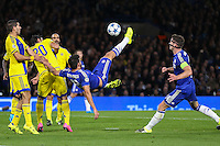Diego Costa of Chelsea (centre) attempts an overhead kick during the UEFA Champions League match between Chelsea and Maccabi Tel Aviv at Stamford Bridge, London, England on 16 September 2015. Photo by David Horn.