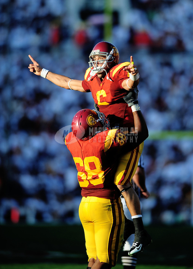 Jan 1, 2009; Pasadena, CA, USA; Southern California Trojans quarterback (6) Mark Sanchez celebrates a second quarter touchdown with offensive tackle (68) Butch Lewis against the Penn State Nittany Lions during the Rose Bowl game at the Rose Bowl. Mandatory Credit: Mark J. Rebilas-