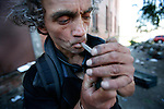 A local drug addict named Ricky smokes a crack pipe at one of the main shooting galleries for intravenous drug-users in downtown Victoria, BC, British Columbia, Canada. Photo shot for the NATIONAL POST.