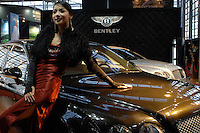 "A model drapes herself across a Bentley at the ""Top Show"" luxury goods fair in Shenzhen, China..18 Dec 2006"