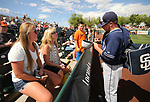 Padres' Colby Blueberg talks with friends, left, while signing autographs for kids at a spring training game in Scottsdale, Ariz., on Saturday, March 25, 2017. The San Francisco Giants beat the Padres 8-7. <br />