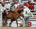 PRCA cowboy Blaze Hamaker is launched from the bronc Belle Star during final round saddle bronc action at the 112th annual Cheyenne Frontier Days Rodeo July 27, 2008 in Cheyenne, Wyoming.
