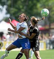 Christine Latham (7) and Rachel Buehler (4) go up for the header. FC Gold Pride defeated the Boston Breakers 2-1 at Buck Shaw Stadium in Santa Clara, California on April 5th, 2009. Photo by Kelley Cox /isiphotos.com