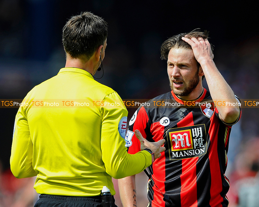 Referee Mark Clattenburg has words with Harry Arter of AFC Bournemouth during AFC Bournemouth vs West Bromwich Albion, Barclays Premier League Football at the Vitality Stadium on 7th May 2016