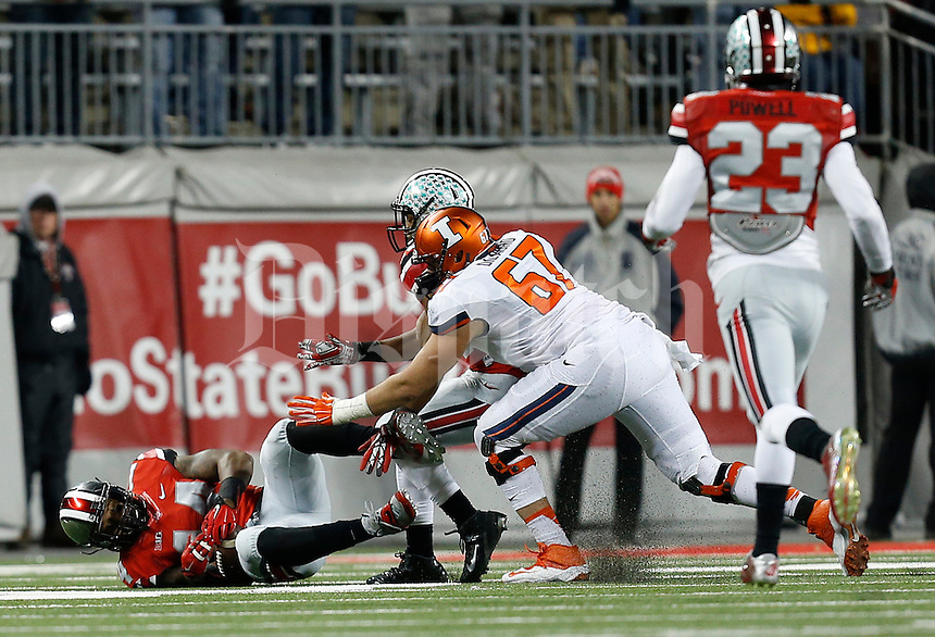 Ohio State Buckeyes linebacker Curtis Grant (14) recovers a fumble in the third quarter the college football game between the Ohio State Buckeyes and the Illinois Fighting Illini at Ohio Stadium in Columbus, Saturday night, November 1, 2014. (The Columbus Dispatch / Eamon Queeney)