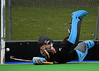 NPGHS goalkeeper Natalia Roughton is beaten during the 2017 Jenny Hair Cup girls hockey match between Horowhenua College (white and red) and New Plymouth Girls' High School (navy) at Hockey Manawatu Twin Turfs in Palmerston North, New Zealand on Wednesday, 6 September 2017. Photo: Dave Lintott / lintottphoto.co.nz