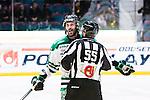 Stockholm 2014-03-21 Ishockey Kvalserien AIK - R&ouml;gle BK :  <br /> R&ouml;gles Andreas Lilja reagerar under ett br&aring;k med AIK:s Martin Karlsson i den tredje perioden<br /> (Foto: Kenta J&ouml;nsson) Nyckelord:  slagsm&aring;l br&aring;k fight fajt gruff arg f&ouml;rbannad ilsk ilsken sur tjurig angry