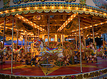 Fairground carousel ride with horses and no people, Weymouth, Dorset, England
