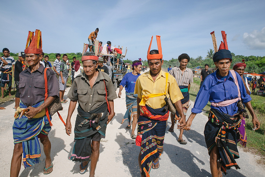 The Ratos, Sumbanese spiritual leader, march around the Pasola arena in Bondo Kawango, Kodi, before the event begun later in the day. Pasola is an ancient tradition from the Indonesian island of Sumba. Categorized as both extreme traditional sport and ritual, Pasola is an annual mock horse warfare performed in response to the harvesting season. In the battelfield, the Pasola warriors use blunt spears as their weapon. However, fatal accident still do occurs.