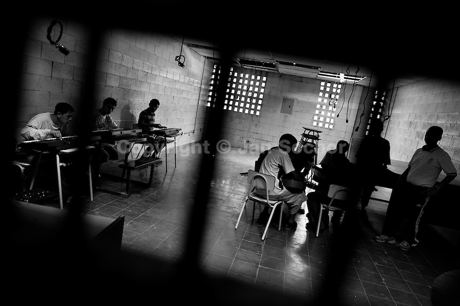Members of the Mara Salvatrucha gang (MS-13) play music during the resocialization classes in the prison of Tonacatepeque, El Salvador, 18 May 2011. During the last two decades, Central America has become the deadliest region in the world that is not at war. According to the UN statistics, more people per capita were killed in El Salvador than in Iraq, in recent years. Due to the criminal activities of Mara Salvatrucha (MS-13) and 18th Street Gang (M-18), the two major street gangs in El Salvador, the country has fallen into the spiral of fear, violence and death. Thousands of Mara gang members, both on the streets or in the overcrowded prisons, organize and run extortions, distribution of drugs and kidnappings. Tattooed armed young men, mainly from the poorest neighborhoods, fight unmerciful turf battles with their coevals from the rival gang, balancing between life and death every day. Twenty years after the devastating civil war, a social war has paralyzed the nation of El Salvador.