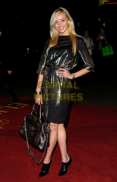 "NOELLE RENO.UK Premiere of ""Elizabeth - The Golden Age"" at the Odeon Leicester Square, London, England..October 23rd 2007.full length black gold metallic shiny dress bag shoes boots hand on hip  .CAP/CAN.©Can Nguyen/Capital Pictures"
