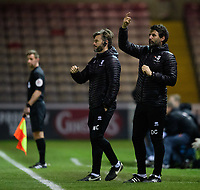 Lincoln City's assistant manager Nicky Cowley, left, and Lincoln City manager Danny Cowley<br /> <br /> Photographer Chris Vaughan/CameraSport<br /> <br /> The EFL Checkatrade Trophy Northern Group H - Lincoln City v Wolverhampton Wanderers U21 - Tuesday 6th November 2018 - Sincil Bank - Lincoln<br />  <br /> World Copyright © 2018 CameraSport. All rights reserved. 43 Linden Ave. Countesthorpe. Leicester. England. LE8 5PG - Tel: +44 (0) 116 277 4147 - admin@camerasport.com - www.camerasport.com