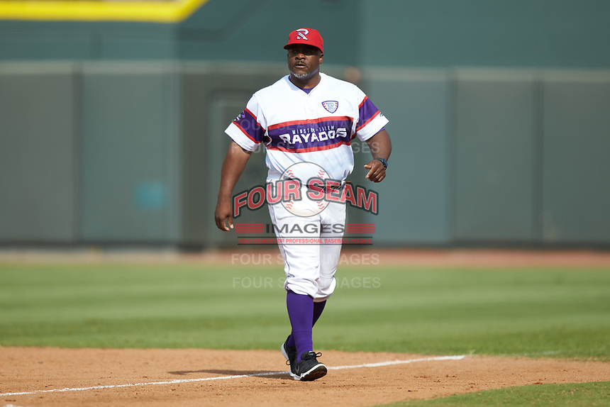 Winston-Salem Rayados hitting coach Charlie Poe (44) walks off the field after having been ejected from the game against the Potomac Nationals at BB&T Ballpark on August 12, 2018 in Winston-Salem, North Carolina. The Rayados defeated the Nationals 6-3. (Brian Westerholt/Four Seam Images)