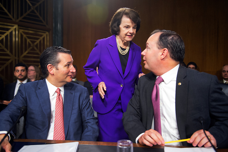 "UNITED STATES - JULY 21: From left, Sens. Ted Cruz, R-Texas, Dianne Feinstein, D-Calif., and Mike Lee, R-Utah, attend a Senate Judiciary Committee hearing in Dirksen Building titled ""Oversight of the Administration's Misdirected Immigration Enforcement Policies: Examining the Impact on Public Safety and Honoring the Victims,"" July 21, 2015. The hearing featured testimony of families of victims who were killed by undocumented immigrants. (Photo By Tom Williams/CQ Roll Call)"