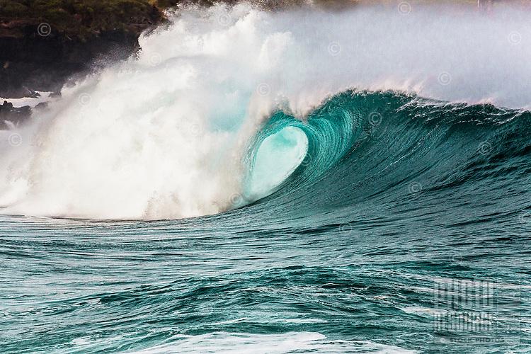 A big hollow wave breaks at Waimea Shorebreak in Waimea Bay, North Shore, O'ahu.