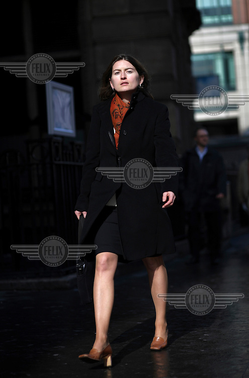 Milena Stoyanova rushing for an urgent meeting in the City of London. The UK went into recession in the final quarter of 2008 as the City was hit hard by the global credit crunch.