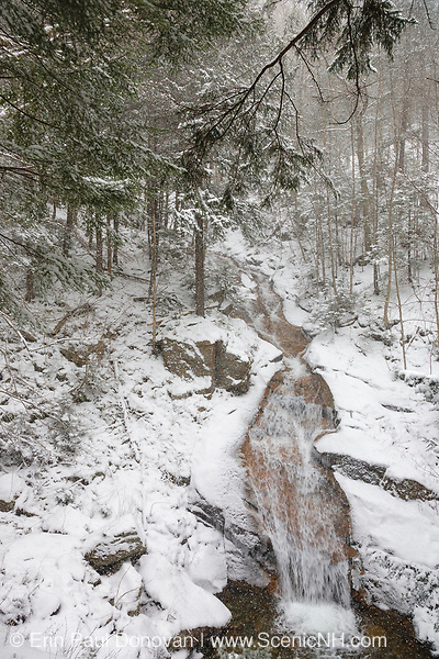 Franconia Notch State Park - Liberty Gorge Cascade during a snow storm in Lincoln, New Hampshire USA. This waterfall is located in the Flume Gorge along Cascade Brook.