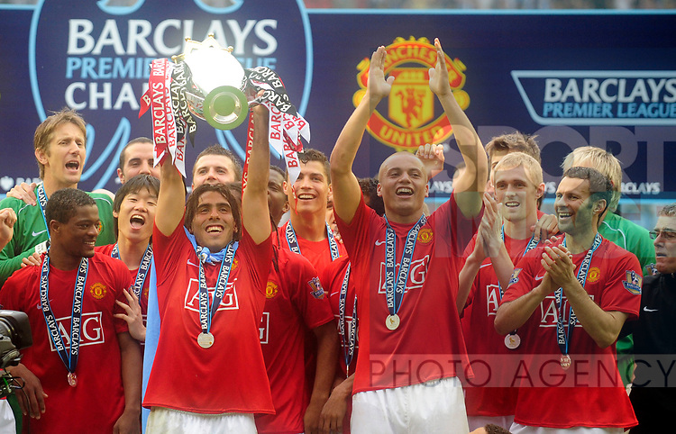 Carlos Tevez of Manchester United celebrates winning the Premier League during the Premier League match at The JJB Stadium, Wigan. Picture date 11th May 2008. Picture credit should read: Simon Bellis/Sportimage