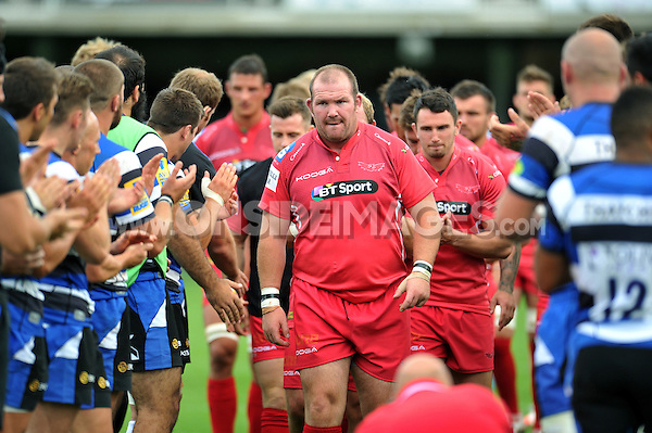 Phil John and the rest of the Scarlets team leave the pitch. Pre-season friendly match, between Bath Rugby and the Scarlets on August 16, 2014 at the Recreation Ground in Bath, England. Photo by: Patrick Khachfe / Onside Images