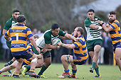 Timothy Taefu is tackled by Broc Hooper and Tamati Fromm. Counties Manukau Premier Club Rugby Semi-final game between Patumahoe and Manurewa, played at Patumahoe on Saturday July 14th 2018. Patumahoe won the game 29 - 28 after trailing 7 - 14 at halftime. <br /> Photo by Richard Spranger.