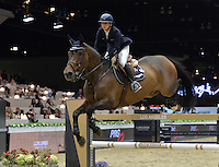 Jane Richard Phillips (Switzerland), riding Dieudonne de Guldenboom at the Gucci Gold Cup International Jumping competition at the 2015 Longines Masters Los Angeles at the L.A. Convention Centre.<br /> October 3, 2015  Los Angeles, CA<br /> Picture: Paul Smith / Featureflash