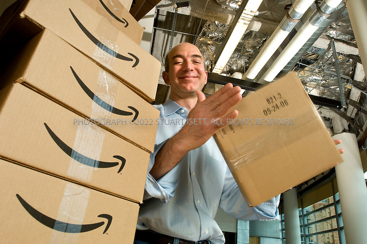 4/24/2007--Seattle, WA, USA..Jeff Bezos, CEO of Amazon.com posing with Amazon delivery boxes, while spinning an unlabeled box, at the company's headquarters in Seattle, WA....Photograph ©2007 Stuart Isett.All rights reserved