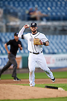 Syracuse Chiefs third baseman Jason Martinson (5) throws to first base during a game against the Louisville Bats on June 6, 2016 at NBT Bank Stadium in Syracuse, New York.  Syracuse defeated Louisville 3-1.  (Mike Janes/Four Seam Images)