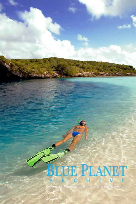 A snorkeler cruises along the shallow edge of the famous Dean's Blue Hole, Long Island, Bahamas, Atlantic Ocean(MR)
