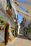 Attractive shaded houses cobbled street in of part of city, Horno de Porras, Cordoba, Spain