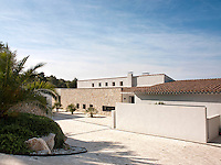 The exterior of a contemporary villa utilising natural stone to blend in with the environment.