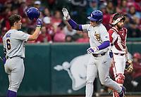 NWA Democrat-Gazette/BEN GOFF @NWABENGOFF<br /> Gavin Dugas (6), LSU second baseman, welcomes Daniel Cabrera, LSU left fielder, as Cabrera scores on a solo home run in the 2nd inning vs Arkansas Thursday, May 9, 2019, at Baum-Walker Stadium in Fayetteville.